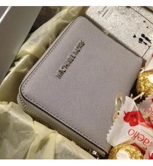 Сірий гаманць Michael Kors